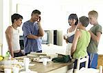 Family standing around table Stock Photo - Premium Royalty-Free, Artist: Transtock, Code: 695-05774181