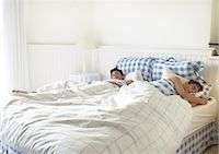 Two teenage boys sleeping in bed Stock Photo - Premium Royalty-Freenull, Code: 695-05774186