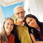 Senior man standing between two girls, smiling, portrait Stock Photo - Premium Royalty-Free, Artist: Transtock, Code: 695-05774193