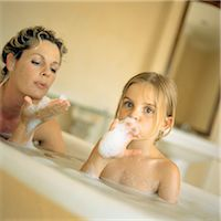 Woman and girl in bubble bath Stock Photo - Premium Royalty-Freenull, Code: 695-05774222