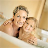 Woman and girl in bathtub, smiling, portrait Stock Photo - Premium Royalty-Freenull, Code: 695-05774223