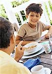 Father and son at table, close-up Stock Photo - Premium Royalty-Free, Artist: Transtock, Code: 695-05774349