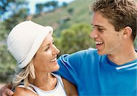 Teenage boy and mature woman smiling at each other, close-up Stock Photo - Premium Royalty-Freenull, Code: 695-05774358