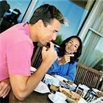 Couple having breakfast, smiling Stock Photo - Premium Royalty-Free, Artist: Transtock, Code: 695-05774397