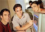 Two men and woman grouped around computer, smiling Stock Photo - Premium Royalty-Free, Artist: Transtock, Code: 695-05774433