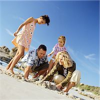 Family digging in sand Stock Photo - Premium Royalty-Freenull, Code: 695-05774506