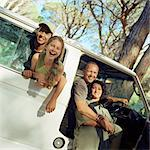 Family portrait, children sticking heads out of van window, parents in open door of van Stock Photo - Premium Royalty-Free, Artist: Transtock, Code: 695-05774517