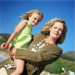 Woman carrying little girl, portrait Stock Photo - Premium Royalty-Freenull, Code: 695-05774529