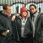 Three young people, standing in front of graffitied wall Stock Photo - Premium Royalty-Free, Artist: Jon Feingersh, Code: 695-05774821