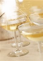 Champagne and sparkler, close-up. Stock Photo - Premium Royalty-Freenull, Code: 695-05774887