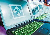 Laptops in a row, digital composite. Stock Photo - Premium Royalty-Freenull, Code: 695-05775017
