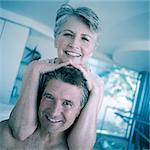 Mature woman, hands on man's head, smiling Stock Photo - Premium Royalty-Freenull, Code: 695-05775117