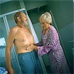 Mature woman touching man's bare stomach Stock Photo - Premium Royalty-Freenull, Code: 695-05775144