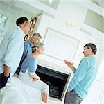 Four mature people talking in a room Stock Photo - Premium Royalty-Freenull, Code: 695-05775183