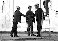 professional (pertains to traditional blue collar careers) - Men wearing hard hats, shaking hands Stock Photo - Premium Royalty-Freenull, Code: 695-05776047