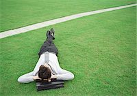 Man lying on grass, head on briefcase Stock Photo - Premium Royalty-Freenull, Code: 695-05776310