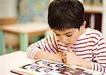 Child reading, close-up Stock Photo - Premium Royalty-Freenull, Code: 695-05776434