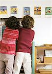 Two children side by side, rear view Stock Photo - Premium Royalty-Free, Artist: Blend Images, Code: 695-05776447