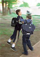 student fighting - Children playfighting, full length, blurred motion Stock Photo - Premium Royalty-Freenull, Code: 695-05776466