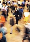 Man standing still in crowd, blurred motion Stock Photo - Premium Royalty-Freenull, Code: 695-05776520