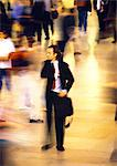 Businessman in crowd, blurred motion Stock Photo - Premium Royalty-Freenull, Code: 695-05776522
