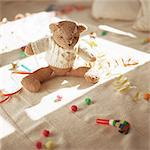 Stuffed teddy bear on floor with party favors Stock Photo - Premium Royalty-Free, Artist: ableimages, Code: 695-05776539