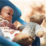 Teddy bear sitting in chair with baby doll Stock Photo - Premium Royalty-Freenull, Code: 695-05776556