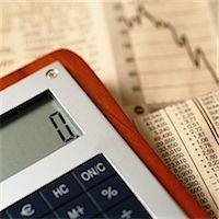 Calculator on top of financial charts Stock Photo - Premium Royalty-Freenull, Code: 695-05776593