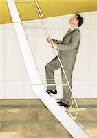 Man climbing ladder Stock Photo - Premium Royalty-Freenull, Code: 695-05777026
