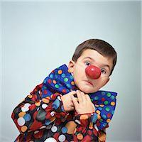 Boy dressed up as clown Stock Photo - Premium Royalty-Freenull, Code: 695-05777051