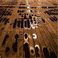 Puddles of rain on boardwalk at night Stock Photo - Premium Royalty-Freenull, Code: 695-05777079
