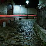 Cobbled street at night and red light trails, long exposure Stock Photo - Premium Royalty-Free, Artist: Transtock, Code: 695-05777097