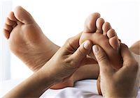 foot massage - Foot massage, close-up Stock Photo - Premium Royalty-Freenull, Code: 695-05777359