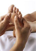 foot massage - Foot massage, close-up Stock Photo - Premium Royalty-Freenull, Code: 695-05777360