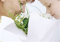 Grandmother and grandson smelling bouquet of flowers Stock Photo - Premium Royalty-Freenull, Code: 695-05777489