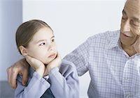 sad girls - Grandfather with arm around sulking granddaughter Stock Photo - Premium Royalty-Freenull, Code: 695-05777510