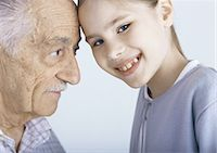 Grandfather and granddaughter touching foreheads, portrait Stock Photo - Premium Royalty-Freenull, Code: 695-05777517