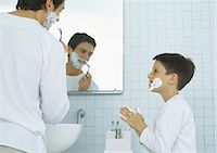 Man shaving, boy with shaving cream on face and hands Stock Photo - Premium Royalty-Freenull, Code: 695-05777649
