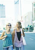 Two teenage girls walking in city Stock Photo - Premium Royalty-Freenull, Code: 695-05778004