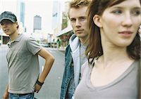 Young people standing in street Stock Photo - Premium Royalty-Freenull, Code: 695-05778017