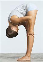 Woman doing forward bend Stock Photo - Premium Royalty-Freenull, Code: 695-05778656