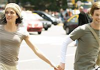 Young couple holding hands in busy street Stock Photo - Premium Royalty-Freenull, Code: 695-05778893