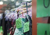 percentage symbol - Rack of sale clothing Stock Photo - Premium Royalty-Freenull, Code: 695-05778943