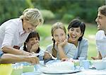 Family having outdoor birthday party Stock Photo - Premium Royalty-Free, Artist: Susan Findlay, Code: 695-05779059