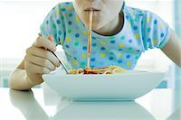 sucking - Girl eating spaghetti with tomato sauce, cropped view Stock Photo - Premium Royalty-Freenull, Code: 695-05779156