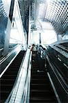 People going up escalator, rear view Stock Photo - Premium Royalty-Freenull, Code: 695-05779599