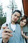 Young couple photographing selves with cell phone Stock Photo - Premium Royalty-Freenull, Code: 695-05779623