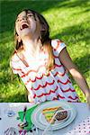 Girl with plate of sweets laughing Stock Photo - Premium Royalty-Free, Artist: Arcaid, Code: 695-05779983