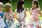 Children at outdoor birthday party Stock Photo - Premium Royalty-Free, Artist: Daisy Gilardini, Code: 695-05779989