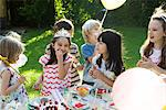 Children eating sweets at birthday party Stock Photo - Premium Royalty-Free, Artist: Susan Findlay, Code: 695-05780001
